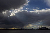 Storm clouds over the Thames, Canary Wharf and Tate & Lyle sugar refinery. Silvertown, East London. - Jess Hurd - 23-03-2014