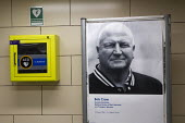 Tribute to Bob Crow, RMT Gen Sec who died of a heart attack, placed next to a defibrillator machine. Mile End Station, Central Line, East London. - Jess Hurd - 26-03-2014