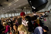 Amargite Singh CWU waving a ballot box. Labour Party Special Conference on reform of its link to trade unions, ExCel Centre, London. - Jess Hurd - 2010s,2014,asian,asians,Ballot Box,BAME,BAMEs,Black,BME,bmes,box,boxes,Collins,Conference,conferences,CWU,debate,debating,delegate,delegates,democracy,diversity,ethnic,ethnicity,funding,member,member