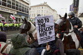 Anti fascist protesters demonstrate against March for England, Brighton. - Jess Hurd - ,2010s,2014,activist,activists,adult,adults,against,animal,animals,Anti Racism,anti racist,CAMPAIGN,campaigner,campaigners,CAMPAIGNING,CAMPAIGNS,CLJ,Day,DEMONSTRATING,Demonstration,DEMONSTRATIONS,dome