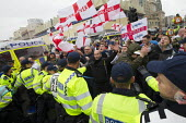 March for England protesters celebrate St George's Day, with a large policing operation and local opposition. Brighton. - Jess Hurd - 2010s,2014,activist,activists,adult,adults,CAMPAIGN,campaigner,campaigners,CAMPAIGNING,CAMPAIGNS,CLJ,Day,DEMONSTRATING,Demonstration,DEMONSTRATIONS,FLAG,flags,force,George,George's,male,man,MATURE,men