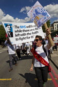 East London GP join a Save our Surgeries protest led by a banner with a Nye Bevan NHS quote. Changes to general practice funding will threaten the financial viability of 98 practices across the countr... - Jess Hurd - 05-06-2014