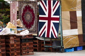 Union Jack rug for sale, Bethnal Green market, East London. - Jess Hurd - ,2010s,2014,Bengali,BME black,bought,buy,buyer,buyers,buying,carpet carpets,commodities,commodity,consumer,consumers,customer,customers,dress,EBF Economy,ethnic,ETHNICITY,flag,flag flags,FLAGS,goods,h