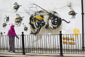 Save the Bees graffiti. Artist Louis Masai raising awareness of a potential eco-catastrophe with his #saveTheBees mural. East London. - Jess Hurd - 2010s,2014,ACE,animal,animals,art,Artist,ARTISTS,arts,artwork,artworks,BAME,BAMEs,bee,bees,Black,BME,bmes,cities,city,conservation,culture,diversity,dress,ecology,ENI,environment,Environmental degrada