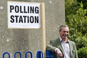 Nigel Farage, UKIP leader casts his European Election vote at his local Polling Station, Surrey. - Jess Hurd - 2010s,2014,campaign,campaigning,CAMPAIGNS,democracy,eurosceptic,Euroscepticism,eurosceptics,leader,local,people,POL,political,POLITICIAN,POLITICIANS,Politics,Station,STATIONS,UK Independence Party,UK