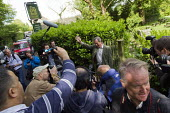Nigel Farage, UKIP leader walks past his local pub, The Old Jail after casting his European Election vote at his local Polling Station, Surrey. - Jess Hurd - 2010s,2014,camera,camera cameras,cameras,campaign,campaigning,CAMPAIGNS,candidate candidates,democracy,election elections,EU,European Union,eurosceptic,Euroscepticism,eurosceptics,Husting,hustings,Jai