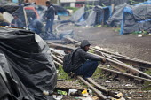 Refugees shelter in makeshift camps prior to an eviction planned by French authorities. Calais, France. - Jess Hurd - 2010s,2014,asleep,Asylum Seeker,Asylum Seeker,BME black,border,border control,border controls,borders,camp,camps,Diaspora,displaced,dock,docks,dockside quay quayside,ethnic,ETHNICITY,eu,Europe,europea
