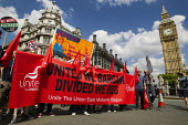 Unite banner marches into Parliament Square. People Assembly demonstration against austerity and the Coalition Government. London. - Jess Hurd - 21-06-2014
