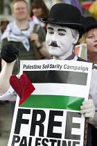 Charlie Chaplin, Thousands join a Stop The War march against the Israeli war on Gaza. London. - Jess Hurd - 26-07-2014