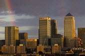 Sunset and rainbow over Canary Wharf financial and business district, London Docklands. - Jess Hurd - 06-07-2014