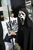Protestors from Campaign Against the Arms Trade outside Airbus Group highlighting that they are arms traders and claiming MDBA, a subsidary, is a missile developer and manufacturer that has contracted... - Jess Hurd - 25-07-2014
