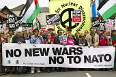 No NATO Newport, Stop the War protest. South Wales. - Jess Hurd - 2010s,2014,activist,activists,against,anti war,Antiwar,banner,banners,CAMPAIGN,Campaign for Nuclear Disarmament,campaigner,campaigners,CAMPAIGNING,CAMPAIGNS,CND,CND Symbol,DEMONSTRATING,Demonstration,