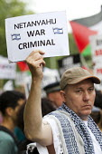 Netanyahu war criminal. Protest in support of Gaza outside the Israeli Embassy, called by the Palestine Solidarity Campaign. London. - Jess Hurd - 01-08-2014