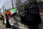 The wall must fall, reference to the Israeli aparthid wall. Peace protesters hang banners from the security fence at Cardiff Castle, a NATO Summit venue, Cardiff, South Wales. - Jess Hurd - 31-08-2014