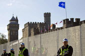 Policing around the security fence at Cardiff Castle, a NATO Summit venue, Cardiff, South Wales. - Jess Hurd - 2010s,2014,adult,adults,Castle,CLJ,conference,conferences,confidence patrol,fence,force,MATURE,NATO,Officer,officers,pol,Police,policeman,policemen,policing,political,POLITICIAN,POLITICIANS,politics,s