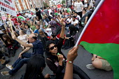 Protest in support of Gaza outside the Israeli Embassy, impromptu march and sit-down in Hammersmith. Called by the Palestine Solidarity Campaign. London. - Jess Hurd - 01-08-2014