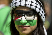 National Demonstration for Gaza. Hyde Park, London. - Jess Hurd - 2010s,2014,activist,activists,CAMPAIGN,campaigner,campaigners,CAMPAIGNING,CAMPAIGNS,DEMONSTRATING,Demonstration,DEMONSTRATIONS,Face,FACES,FEMALE,flag,flags,paint,painting,palestine solidarity campaign