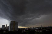 Remnants of Hurricane Bertha as a storm cloud sweeps across from the Shard and the City of London to Canary Wharf. East London. - Jess Hurd - 12-08-2014