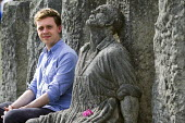 Owen Jones with Tolpuddle Martyrs sculpture of George Loveless in Dorchester Prison by Thompson Dagnall. Tolpuddle Martyrs Festival. Dorset. - Jess Hurd - 19-07-2014