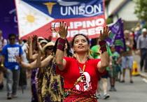 Filipino nurses, Unison banners. Tolpuddle Martyrs Festival. Dorset. - Jess Hurd - 2010s,2014,ACE,banner,banners,culture,dance,dancer,dancers,dancing,FEMALE,festival,FESTIVALS,Filipino,melody,member,member members,members,Migrant Workers,music,MUSICAL,NURSE,nurses,NURSING,PEOPLE,per