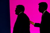 Ed Miliband, Leader of the Labour Party follows Ed Balls off stage after his address to conference as Shadow Chancellor of the Exchequer. Labour Party Conference, Manchester. - Jess Hurd - 22-09-2014