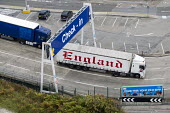 Trucks leaving the Eastern Docks. Port of Dover, Kent. - Jess Hurd - (Transbritannia,2010s,2014,a,ARRIVAL,arrivals,arrive,arrived,arrives,arriving,boarding,boat,boats,capitalism,capitalist,cargo,Cross Channel Ferry,disembark,disembarkation,disembarking,dock,docks,docks