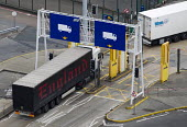 Trucks driving through fixed x-ray cargo screening system at customs, to detect stowaways and illegal goods, Eastern Docks. Port of Dover, Kent. - Jess Hurd - 27-09-2014