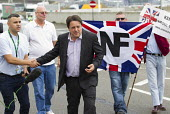 Nick Griffin, BNP joins with NF members and Far right groups as they gather at the Port of Dover in a protest against immigration and in support of truck drivers. Kent. - Jess Hurd - ,2010s,2014,activist,activists,against,Alliance,bigotry,BNP,British National Party,CAMPAIGN,campaigner,campaigners,CAMPAIGNING,CAMPAIGNS,DEMONSTRATING,Demonstration,DEMONSTRATIONS,DISCRIMINATION,East,