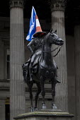 Yes Campaign. A statue of Wellington with traffic cone and Scottish flag the day after polling day in the Scottish Independence Referendum. Glasgow, Scotland. - Jess Hurd - 19-09-2014