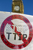 No TTIP, protest against the USA EU Transatlantic Trade and Investment Partnership, a trade deal currently being negotiated between America and the European Union. Parliament Square, Westminster, Lond... - Jess Hurd - 11-10-2014