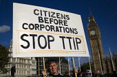 No TTIP, protest against the USA EU Transatlantic Trade and Investment Partnership, a trade deal currently being negotiated between America and the European Union. Parliament Square, Westminster, Lond... - Jess Hurd - 2010s,2014,activist,activist activists,activists,against,american,americans,anti,anti privatisation,anti privatisation,anti privatization,CAMPAIGN,campaigner,campaigners,CAMPAIGNING,CAMPAIGNS,DEMONSTR