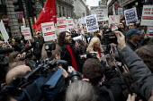 Russell Brand joins parents and children from the New Era Estate as they rally outside Westbrook Partners in Mayfair, en route to delivering a petition to Downing Street, in protest at the corporate t... - Jess Hurd - 2010s,2014,activist,activists,Brand,camera,cameras,CAMPAIGN,campaigner,campaigners,CAMPAIGNING,CAMPAIGNS,child children,communities,community,delivering,DEMONSTRATING,DEMONSTRATION,DEMONSTRATIONS,empl