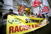 Interserve cleaners picket Waterloo Station in an RMT strike about pay, racism, bullying and union recognition. London. - Jess Hurd - 2010s,2014,anti racism,anti racist,BAME,BAMEs,banner banners,bigotry,black,bme,bme.poc,BME black,bmes,cultural,DISCRIMINATION,DISPUTE,DISPUTES,diversity,equal,equality,ethnic,ethnicity,flag flags,INDU