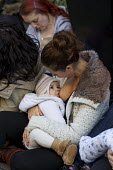 Carla Mastroianni breastfeeds her seven month old daughter, Sienna. Breastfeeding mothers gather outside Claridges Hotel in protest against the discrimination a mother faced whilst feeding her baby. M... - Jess Hurd - 2010s,2014,activist,activists,adult,adults,against,babies,baby,breast,breast feed,breast feeding,breast feeds,breastfed,breastfeed,breastfeeding,breastfeeds,breasts,CAMPAIGN,campaigner,campaigners,CAM