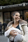 Carla Mastroianni breastfeeds her seven month old daughter, Sienna. Breastfeeding mothers gather outside Claridges Hotel in protest against the discrimination a mother faced whilst feeding her baby. M... - Jess Hurd - ,2010s,2014,activist,activists,adult,adults,against,babies,baby,breast,breast feed,breast feeding,breast feeds,breastfed,breastfeed,breastfeeding,breastfeeds,breasts,CAMPAIGN,campaigner,campaigners,CA