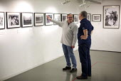 Photographer John Harris with Mike Simons. Still The Enemy Within, miners strike exhibition at Rich Mix, London. - Jess Hurd - 05-12-2014