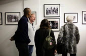 Photographer John Harris talking to visitors about his images at the, Still The Enemy Within, miners strike exhibition at Rich Mix, London. - Jess Hurd - 05-12-2014