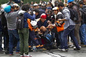 Injured journalist is helped and photographed by his colleagues. Turkish police surround Injured journalist is helped and photographed by his colleagues. Turkish police surround Taksim Square to preve... - Jess Hurd - 01-05-2014