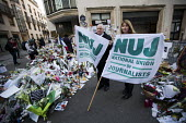 Michelle Stanistreet, NUJ GS and Seamus Dooley, NUJ Irish Secretary in solidarity with Charlie Hebdo, after the shooting of cartoonists in the attack on the Charlie Hebdo magazine offices. Paris. - Jess Hurd - 2010s,2015,activist,activists,attack,attacking,banner,banners,CAMPAIGN,campaigner,campaigners,CAMPAIGNING,CAMPAIGNS,child,CHILDHOOD,children,COMMEMORATE,COMMEMORATING,commemoration,COMMEMORATIONS,comm