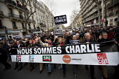 Journalist unions with a banner Nous Sommes Charlie lead the unity march after the shooting of cartoonists in the attack on the Charlie Hebdo magazine offices, Paris. - Jess Hurd - 2010s,2015,activist,activists,attack,attacking,banner,banners,CAMPAIGN,campaigner,campaigners,CAMPAIGNING,CAMPAIGNS,CFDT,CGT,Charlie,child,CHILDHOOD,children,DEMONSTRATING,Demonstration,DEMONSTRATIONS