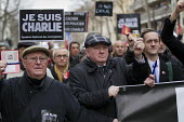 Seamus Dooley, NUJ Irish Sec, Journalist unions with a banner Nous Sommes Charlie lead the unity march after the shooting of cartoonists in the attack on the Charlie Hebdo magazine offices, Paris. - Jess Hurd - 11-01-2015