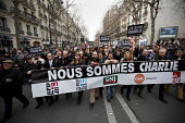 Journalist unions with a banner Nous Sommes Charlie lead the unity march after the shooting of cartoonists in the attack on the Charlie Hebdo magazine offices, Paris. - Jess Hurd - 11-01-2015