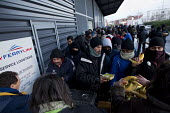 Calais migrants queue in freezing conditions for food provided by Salam. French authorities have instructed the charity to stop serving food on the street. France. - Jess Hurd - 13-01-2015
