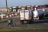 Calais migrants trying to stowaway on trucks bound for the UK. France. - Jess Hurd - 13-01-2015