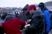 Calais migrants queue in freezing conditions for the last day of food provided by Salam. French authorities have instructed the charity to stop serving food on the street with threats of violence, as... - Jess Hurd - 13-01-2015