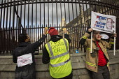 FBU Cleaning Crew spruce up Parliament. Striking firefighters rally and protest outside parliament in a long-running pensions dispute. Westminster. London. - Jess Hurd - 25-02-2015