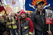 Striking firefighters rally and protest outside parliament in a long-running pensions dispute. Westminster. London. - Jess Hurd - 25-02-2015