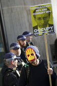 Shell oil mask and Malcom Rifkin placard occupy democracy. Time to Act! Climate Change National Demonstration. London. - Jess Hurd - 07-03-2015