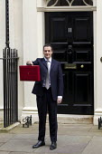 The Chancellor, George Osborne leaves 11 Downing Street to deliver his Budget to Parliament. Westminster, London. - Jess Hurd - 18-03-2015