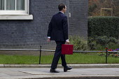 The Chancellor, George Osborne leaves 11 Downing Street to deliver his Budget to Parliament. Westminster, London. - Jess Hurd - ,2010s,2015,Budget Box,CONSERVATIVE,Conservative Party,conservatives,deliver,leaves,London,Ministerial Box,mp,mps,POL,political,politician,politicians,Politics,Street,Westminster
